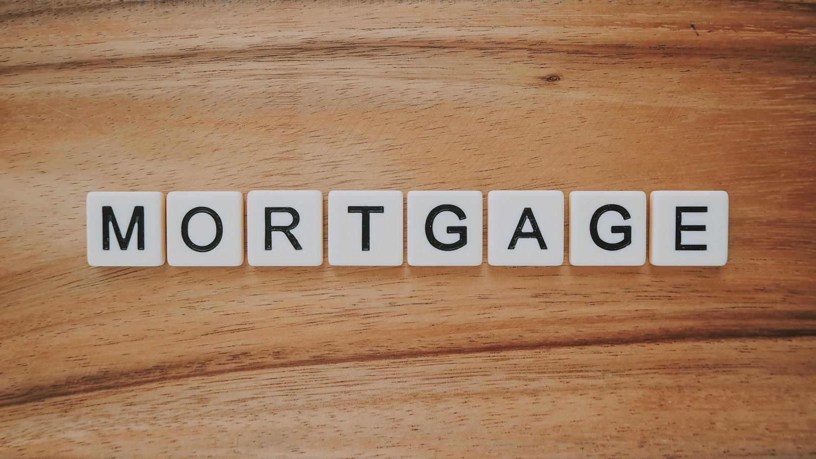 scrabble letters spelling mortgage